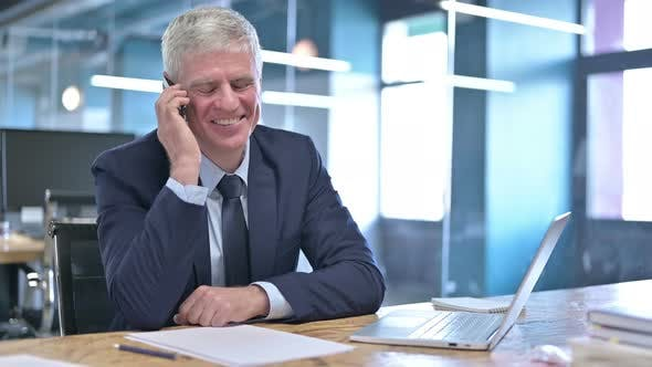 Thumbnail for Cheerful Middle Aged Businessman Talking on Cellphone