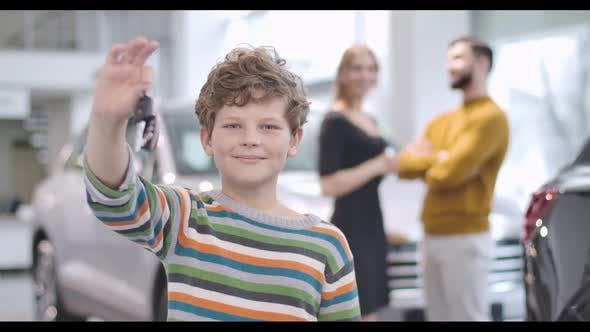 Thumbnail for Cute Caucasian Boy with Curly Hair Showing Car Keys and Thumb Up