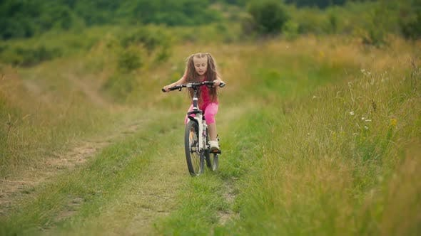 Thumbnail for Girl Riding a Bike
