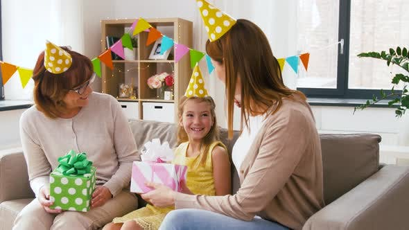 Cover Image for Family Greeting Girl with Birthday at Home Party