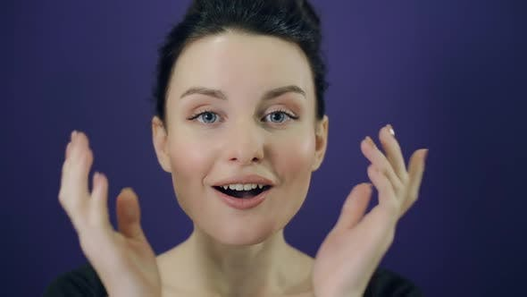 Thumbnail for Surprised Young Woman on Purple Background