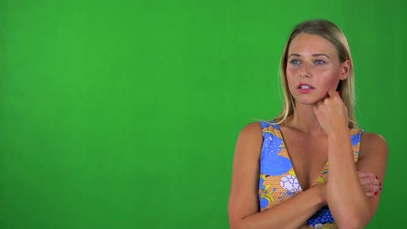 Thumbnail for Young Pretty Blond Woman Thinks About Something - Green Screen - Studio