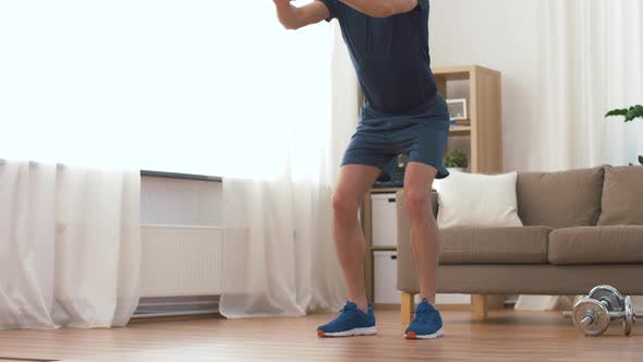 Thumbnail for Man Exercising and Doing Squats at Home