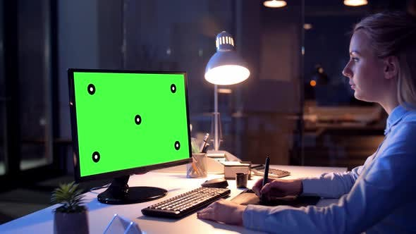 Graphic Designer with Green Screen on Computer 30