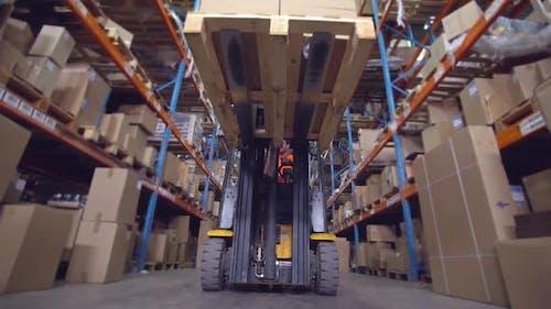 Man Deliver Parcels in Warehouse