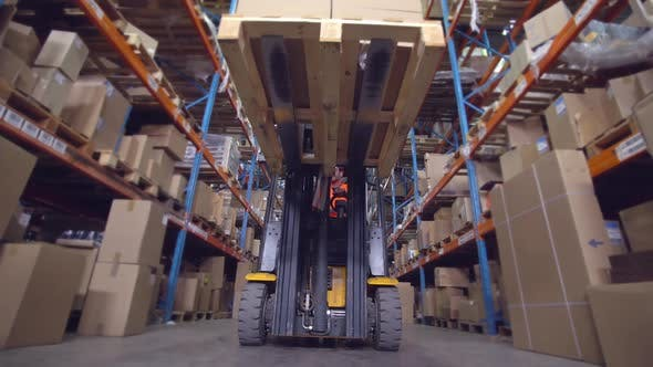 Thumbnail for Man Deliver Parcels in Warehouse