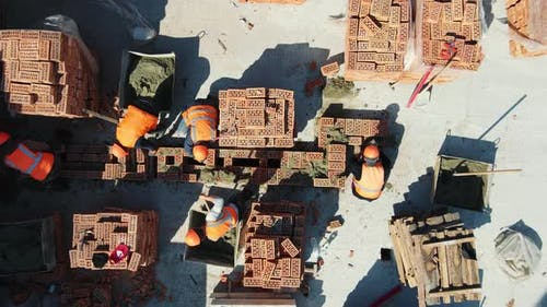 Aerial Top View of Builders Building a House