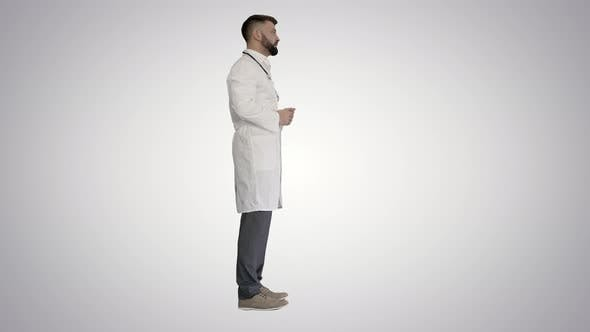Thumbnail for Confident Doctor Talking To Someone on Gradient Background