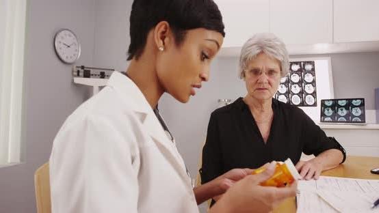 Thumbnail for Mature woman patient receiving prescription medicine