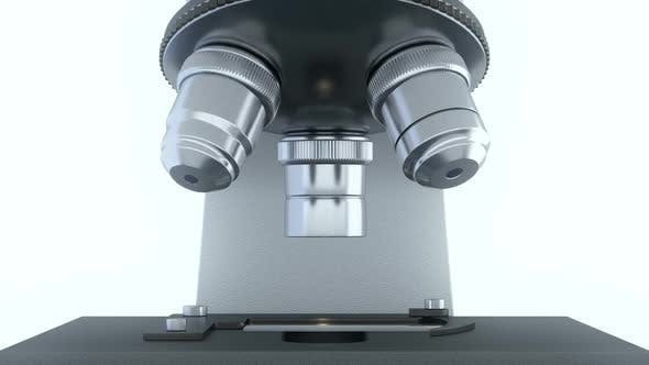 Thumbnail for Laboratory Microscope in Bright White Laboratory Rotating Its Metal Lenses