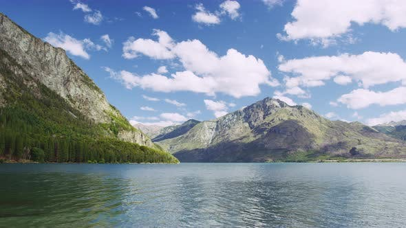 Thumbnail for Mountain Range and Tall Trees From the Lake