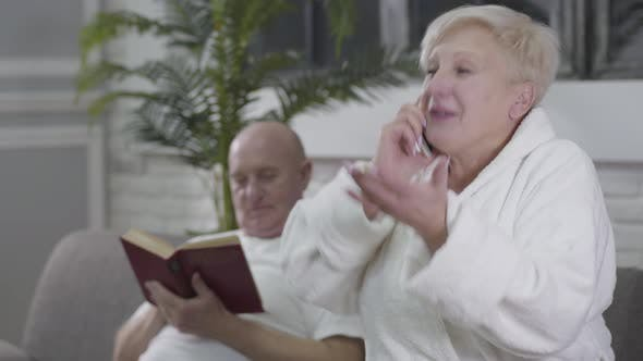 Thumbnail for Positive Old Caucasian Woman with Brown Eyes and Blond Hair Talking on Phone at the Foreground