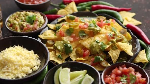 Thumbnail for Fresh Yellow Corn Nacho Chips on Ceramic Plate