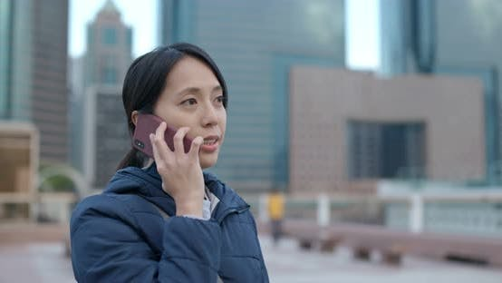 Thumbnail for Woman Talk to Cellphone in City