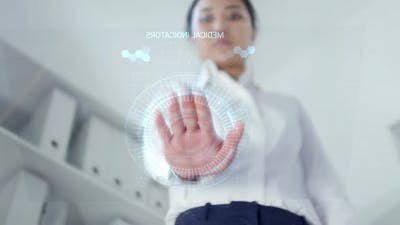 Woman Using Futuristic Device with AR Screen for Medical Checkup