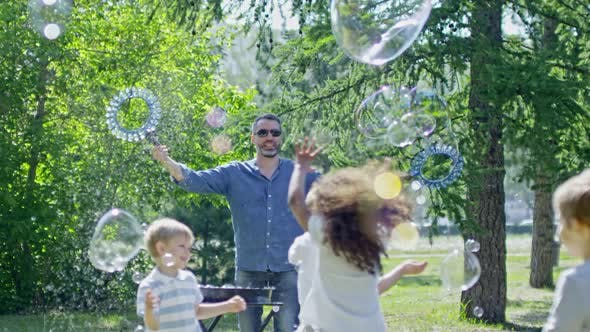 Thumbnail for Little Children Playing at Outdoor Bubble Show