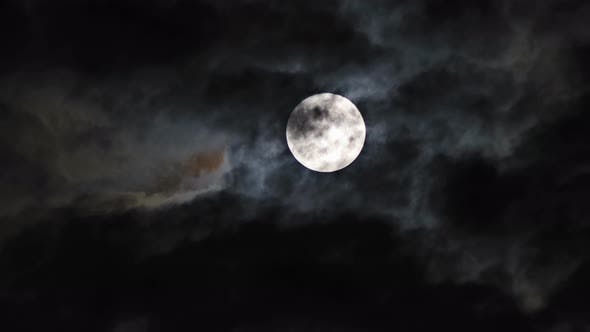 Mysterious night sky with full dramatic moon clouds in the moon light moon.