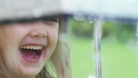 Cover Image for Girl Laughing during Rain