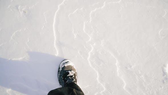 POV View Male Feet Boots Walking Snowy Trail