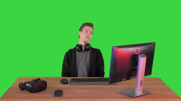Thumbnail for Upset Gamer Expressing Disappointment Watching Online Game on a Green Screen, Chroma Key.
