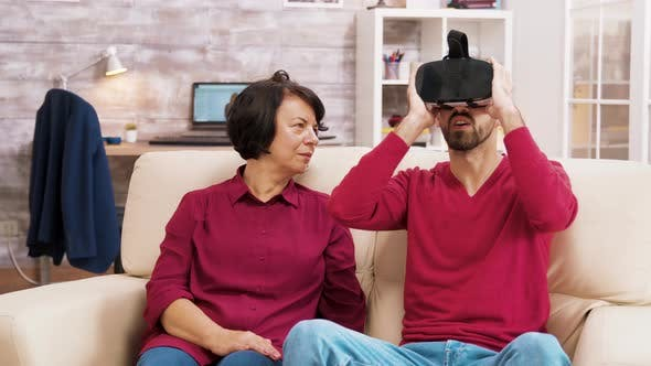 Thumbnail for Nephew Teaching His Grandmother How To Use Virtual Reality Headset