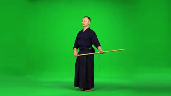 Thumbnail for Masculine Kendo Warrior Practicing Martial Art with the Bamboo Bokken on Green Screen.