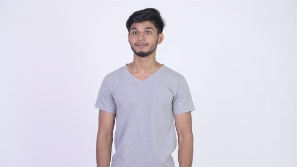 Thumbnail for Young Happy Bearded Indian Man Looking Excited While Giving Thumbs Up