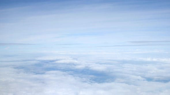 View of sky and clouds from passenger plane
