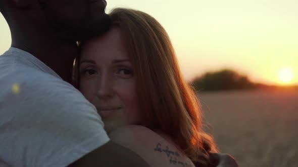 Interracial Couple Hugging
