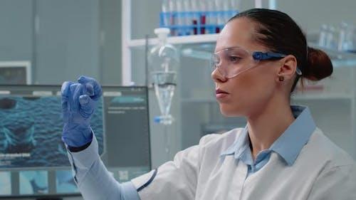 Chemistry Specialist Analyzing Blood Sample on Glass
