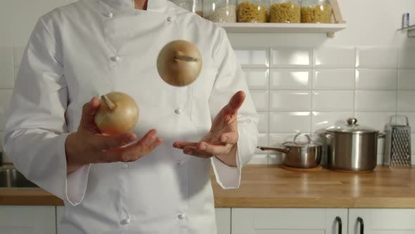 Thumbnail for Chief-Cooker Juggles An Onions In A Kitchen