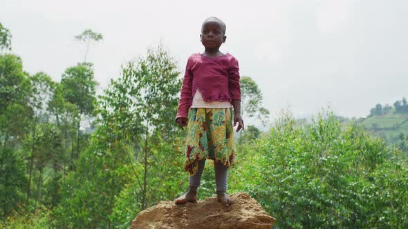 Thumbnail for African child standing on a mound