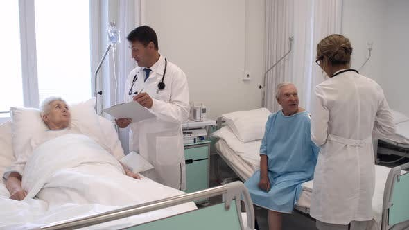 Thumbnail for Healthcare Workers Visiting Patients in Hospital Ward