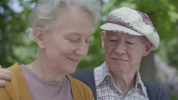 Cover Image for Portrait of a Mature Couple in Love Sitting on a Bench in the Park