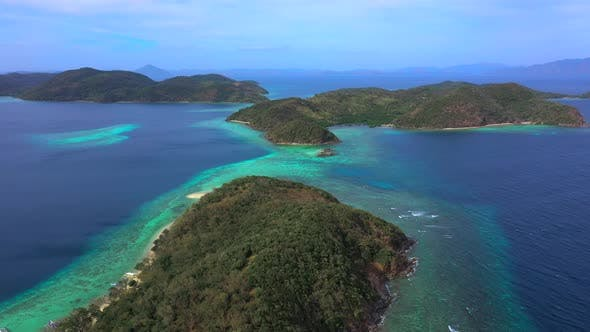 Thumbnail for Panorama of Tropical Islands Surrounded By Turquoise Sea. Camera Move Down. Aerial View