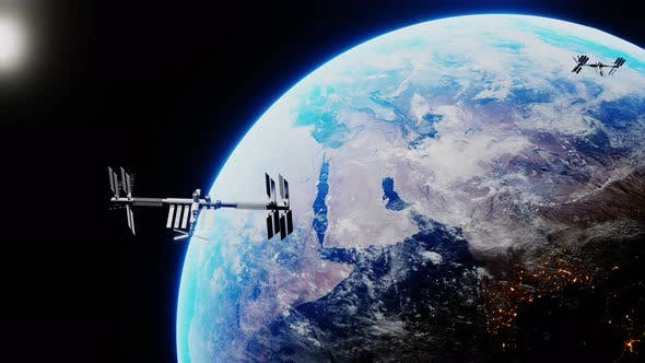 Thumbnail for Space Shuttle and Space Station Orbiting Earth