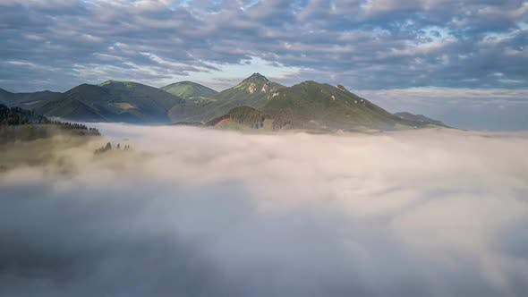 Magic Fly Above Clouds in Green Mountains