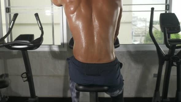 movement of sportman body skin, sweat dripping drop on body skin of sport man after workout