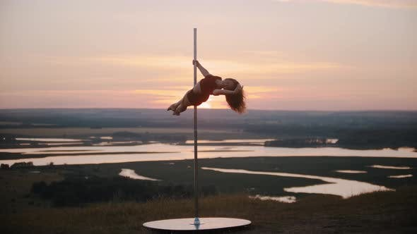 Thumbnail for Young Woman Dancer in Sports Clothes Dancing on the Top of the Pole