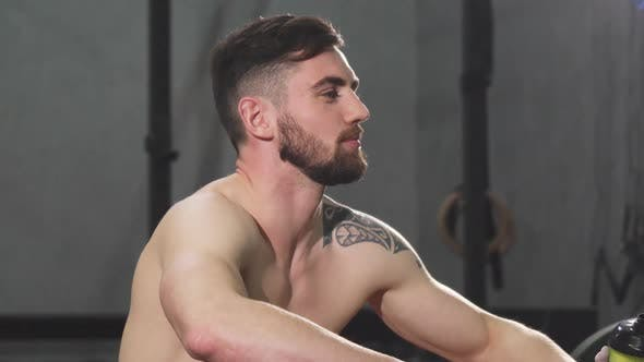 Thumbnail for Handsome Young Bearded Shirtless Athletic Man Relaxing After Working Out