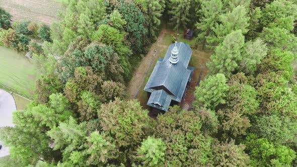 Thumbnail for Wooden Church in Small City Among Pastures. Drone Footage.