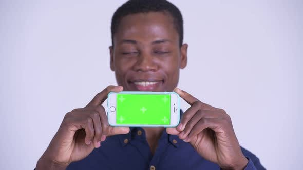 Thumbnail for Face of Young Happy African Businessman Showing Phone