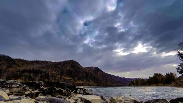 Thumbnail for Time Lapse Shot of a River Near Mountain Forest. Huge Rocks and Fast Clouds Movenings. Horizontal
