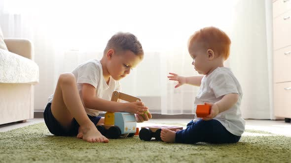 Thumbnail for Boy and Girl Are Playing with Toy Car on a Floor