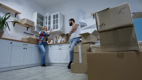 Cover Image for Young Couple Moving in Their New Home