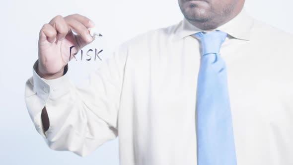 Asian Businessman Writes Risk