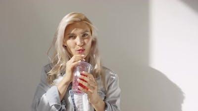 Caucasian Girl in Denim Jacket Posing in Studio