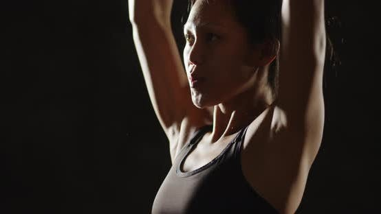 Thumbnail for Active Asian woman working out with dumbbells