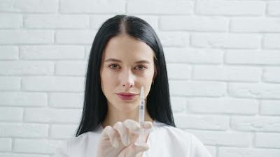 Beautician Holding Syringe for Beauty Injection