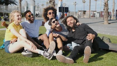Laughing Friends Taking Selfie on Meadow